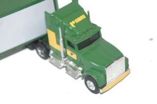 Ertl 1/64 scale semi truck and trailer #9200, 881   New