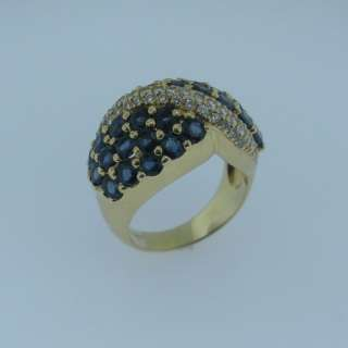 SAPPHIRE and DIAMOND RING, 18 KARAT YELLOW GOLD, SIZE 7